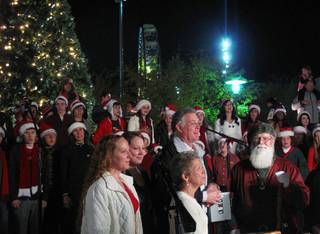 Santa Claus, Henderson Mayor Andy Hafen and his family celebrate during the Winterfest tree-lighting ceremony Friday night. Hundreds were in attendance at the Henderson Events Plaza and Convention Center, 200 S. Water St., to celebrate the holiday season.