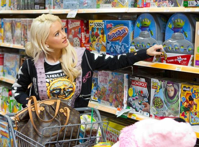 Holly Madison shops for toys at Walmart on Dec. 11, 2010.