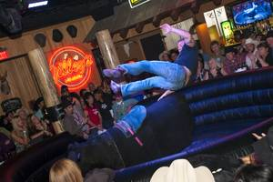 Gutsy riders take a chance at a $200 cash prize during Gilley's Toughest Cowboy Competition on Thursday, Dec. 9, 2010.
