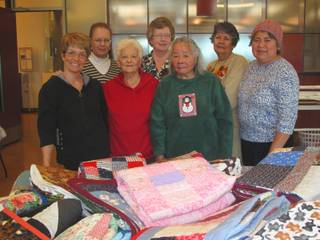 Members of a quilting group at the Heritage Park Senior Center in Henderson pose for a photo on Thursday, Dec. 9, 2010. The group makes quilts and donates them to those in need. In front, from left: Ann Kosewicz, Louise Walder, Blossom Lee; in back, from left: Barbara Collins, Phyllis Ragle, Maria Dissinger, Maria De Walsh.