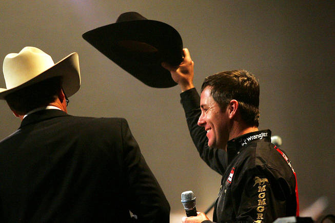 All-around world champion Trevor Brazile doffs his hat during the NFR World Champion Awards Show and After Party at The Mirage on Saturday, Dec. 11, 2010.