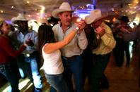 Rodeo fans dance during the NFR World Champion Awards Show and After Party at the Mirage Saturday, December 11, 2010.