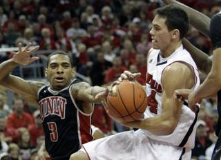 Louisville's Kyle Kuric, right, grabs a rebound away from UNLV's Anthony Marshall (3) in their NCAA college basketball game in Louisville, Ky., Saturday, Dec. 11, 2010. Kuric finished with 17 points and 5 rebounds as No. 24 Louisville beat No. 20 UNLV 77-69.