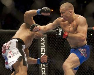 George St-Pierre, right, from Montreal, trades punches with Josh Koscheck, from Waynesburg, Pa., during their welterweight title bout at UFC 124 on Saturday in Montreal. St-Pierre won a unanimous decision to retain his title.