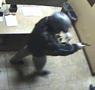 Surveillance video image of an armed man who robbed the Suncoast casino on Dec. 9. Police said he's also suspected in the robbery of the Bellagio on Dec. 14.