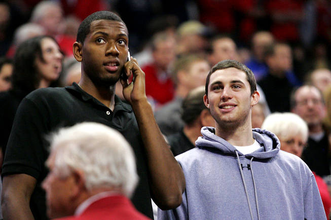 UNLV's Mike Moser, left, takes in the Rebels' game against UC Santa Barbara on Dec. 15, 2010, at the Thomas & Mack Center while hosting UCLA transfer Matt Carlino on an official campus visit.