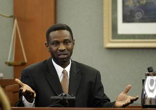 Victor Fakoya testifies on his own behalf during his trial at the Regional Justice Center Thursday, Dec. 16, 2010.