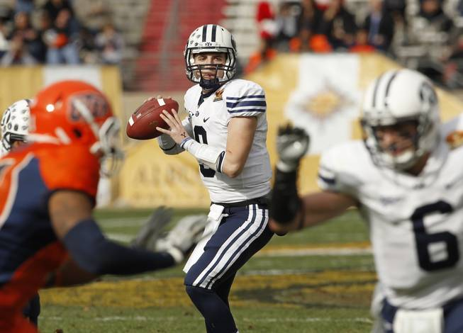 BYU quarterback Jake Heaps looks to pass to McKay Jacobson (6), right, during the first quarter of the New Mexico Bowl NCAA college football game against UTEP, Saturday, Dec. 18, 2010, in Albuquerque, N.M. BYU won, 52-24.