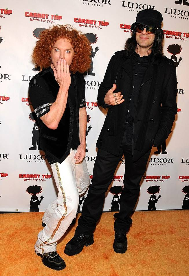Carrot Top, with fellow Luxor headliner Criss Angel, celebrates his fifth anniversary at the Luxor on Dec. 20, 2010.