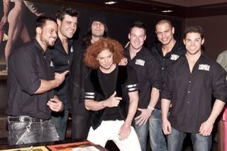 Carrot Top, with Excalibur headliners Thunder From Down Under, celebrates his fifth anniversary at the Luxor on Dec. 20, 2010.