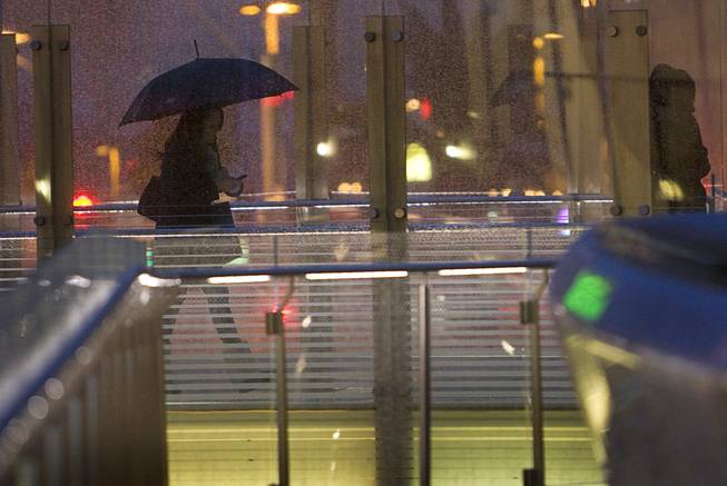 A woman uses a pedestrian walkway at CityCenter on the Las Vegas Strip in the late afternoon Wednesday, Dec. 22, 2010.