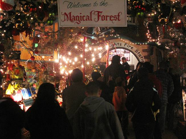 A crowd waits in line for the Northern Lights Fire Station at Opportunity Village's Magical Forest Thursday night. The attraction reopened Thursday at 5:30 p.m. after being forced to close several days due to heavy rainfall.
