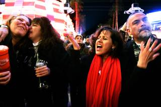 Lorann Watts, from left, and Elma Calderon of Milwaukee and Martha Picemo and Al Picemo of Temecula, Calif., enjoy Heart Alive, a Heart tribute band, during New Year's Eve Tribute Palooza at the Fremont Street Experience in downtown Las Vegas on Friday, Dec. 31, 2010.
