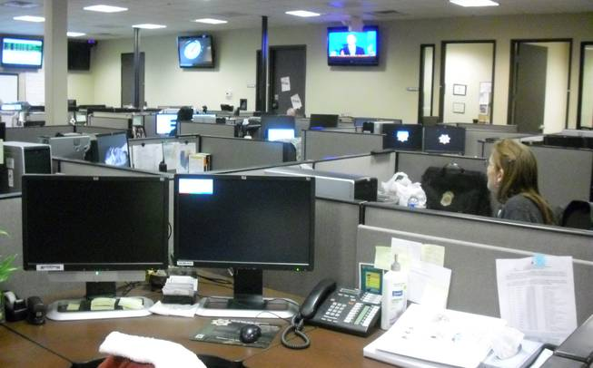 Officials in the analytics section of the Southern Nevada Counter Terrorism Center monitor information via police dispatches, Internet activity and news stations on New Year's Eve.