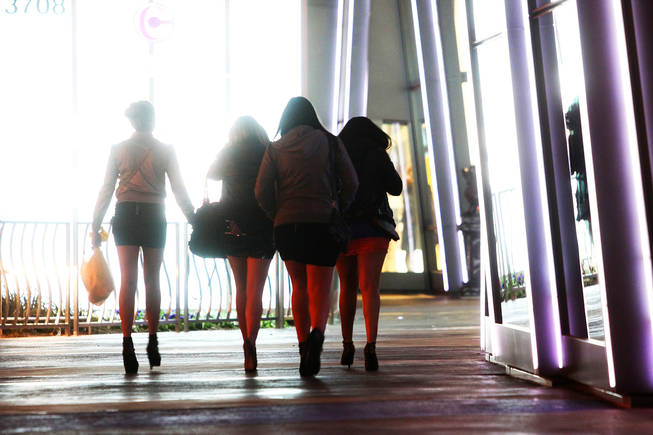 A group of women walk past the Cosmopolitan on the Las Vegas Strip on New Year's Eve 2010.