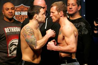 Frank Edgar (L) faces off with Gray Maynard during the weigh in for UFC 125 Friday, December 31, 2010 at the MGM Grand Garden Arena.
