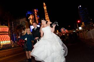 A newlywed couple heads down the Strip to celebrate their marriage on New Year's Eve 2010.