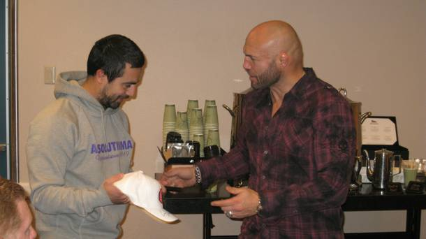 Verifiable badass Randy Couture meets with a fan in the media center at UFC 125 at MGM Grand Garden Arena.