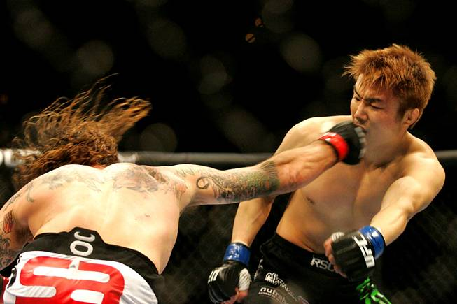 Clay Guida connects with a right on Takamori Gomi  during UFC 125 Saturday, January 1, 2011 at the MGM Grand Garden Arena.  Guida won with a guillotine choke in second round.