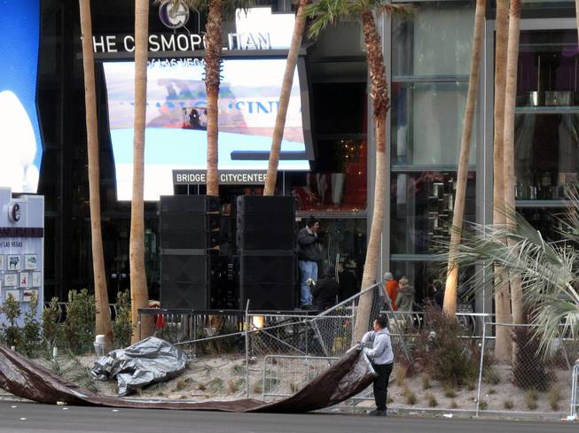 Workers clean up in front of the Cosmopolitan of Las Vegas on the Strip early on New Year's Day.