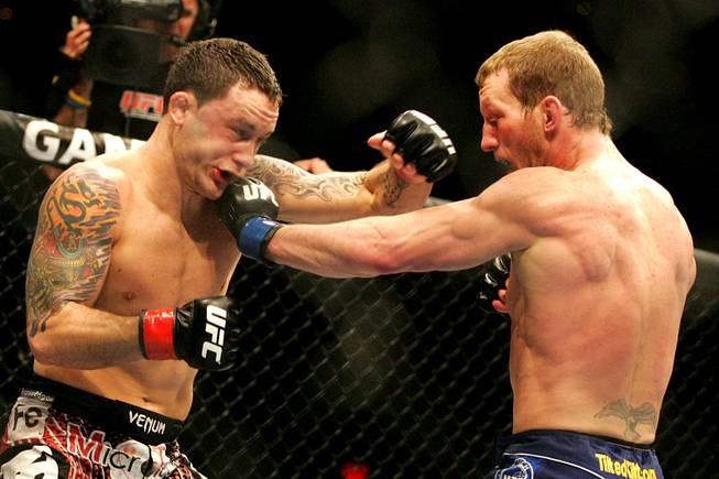 Gray Maynard tags Frankie Edgar with a left during their lightweight title fight at UFC 125 Saturday, January 1, 2011 at the MGM Grand Garden Arena. Maynard and Edgar fought to a draw.