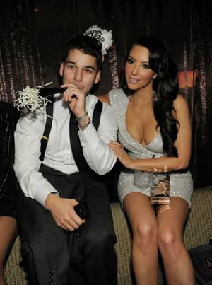 Kim Kardashian, with brother Rob Kardashian, hosts New Year's Eve at Tao at The Venetian on Dec. 31, 2010.