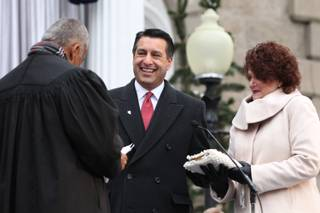 Gov. Brian Sandoval takes the oath of office from Chief Supreme Court Justice Michael Douglas during the inauguration, Jan. 3, 2011 at the Capitol in Carson City. First Lady Kathleen Sandoval is at right.