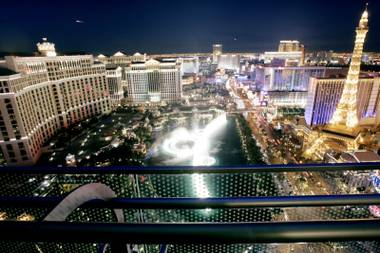 A private terrace of a Cosmopolitan guest room offers a view of the Bellagio Fountains and other properties along The Strip.