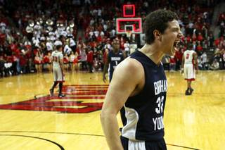 BYU's Jimmer Fredette celebrates after dropping 39 on UNLV in the Thomas & Mack Center on Wednesday, Jan. 5, 2011.  BYU won the game 89-77.