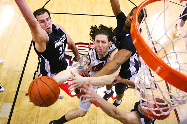 UNLV's Carlos Lopez puts up two points against BYU during the second half of their game Wednesday, January 5, 2011. BYU won the conference opener for both teams 89-77.
