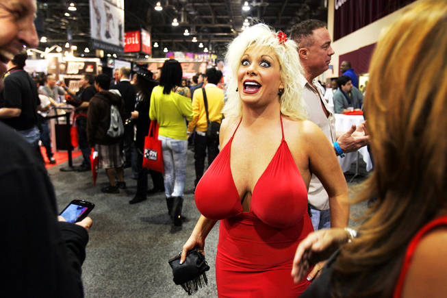 Adult film star Caudia Marie talks with fans at the AVN Adult Entertainment ...