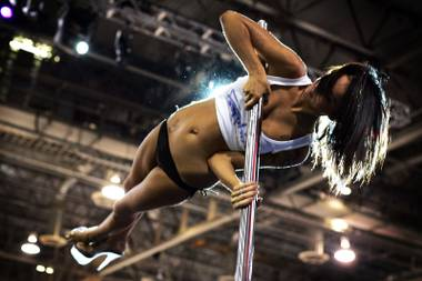 Alex from Sapphire Gentlemen's Club competes in the pole dancing competition at the AVN Adult Entertainment Expo at the Sands Convention Center in Las Vegas on Friday, Jan. 7, 2011.