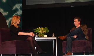 Netflix CEO, Reed Hastings, and Arianna Huffington, co-founder of the Huffington Post, talk during the 2011 Leaders in Technology Dinner Friday night at the Lafite Ballroom in the Wynn Hotel.