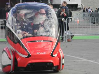 Two riders take a spin in the Jiao model of General Motors' EN-V, which made its North American public debut at the Consumer Electronics Show this week.