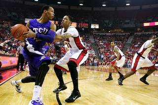 UNLV forward Tre'Von Willis guards TCU forward Garlon Green during the first half of their game Saturday, January 7, 2011 at the Thomas & Mack Center.