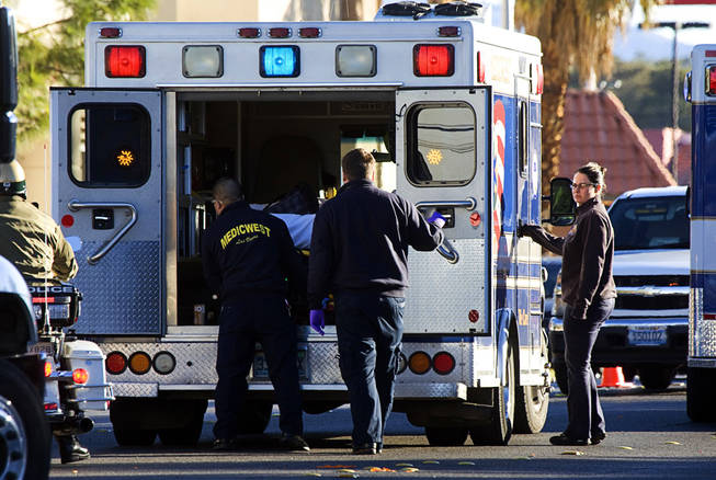 A person is loaded into an ambulance after an accident involving a school bus in the northbound lanes of Eastern Avenue between Tropicana and Harmon avenues, Jan. 10, 2011.