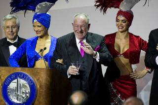 Las Vegas Mayor Oscar Goodman waves before leaving the stage with showgirls after delivering the annual State of the City address at the Cleveland Clinic Lou Ruvo Center for Brain Health in downtown Las Vegas on Tuesday, Jan. 11, 2011.