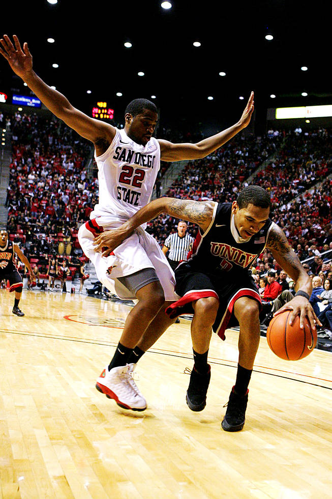 San Diego State's Chase Tapley and UNLV's Anthony Marshall