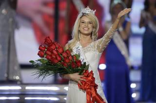 Miss Nebraska Teresa Scanlan, 17, waves after being crowned 2011 Miss America during the Miss America Pageant on Saturday, Jan. 15, 2011,  at Planet Hollywood.