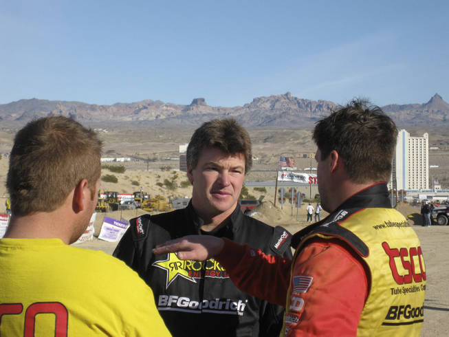 Rob MacCachren talks with a few drivers after the race.