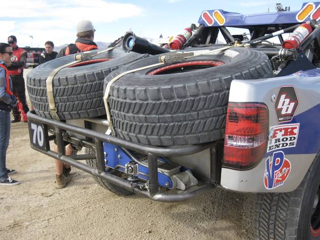 Most of the Trophy-Trucks carry spare tires.  Notice the floor jack strapped to the rear of the truck.