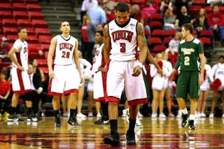 UNLV guard Anthony Marshall heads off the court with his head down after fouling out against Colorado State during a game on Jan. 19, 2011, at the Thomas & Mack Center. Colorado State won, 78-63.