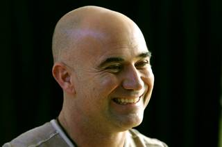 Andre Agassi smiles during an announcement of Agassi's induction into the International Tennis Hall of Fame Thursday, January 20, 2011 at the Andre Agassi College Preparatory Academy. Agassi will be officially inducted July 9th.