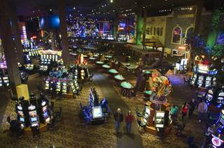 A couple walks though the casino floor at Buffalo Bill's in Primm on Thursday, Jan. 20, 2011. The casino recently replaced older light bulbs with energy-efficient lighting throughout the casino.
