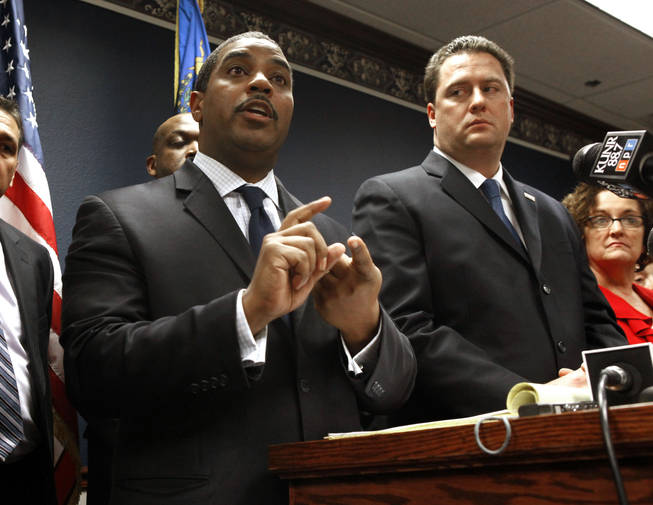 Nevada Senate Majority Leader Steven Horsford, D-North Las Vegas, left, discuses his opposition to Gov. Brian Sandoval's proposed state budget cuts during a news conference after Sandoval's State of the State address before a joint session of the Nevada Legislature in Carson City on Monday Jan. 24, 2011.  At right is Assembly Speaker-elect John Oceguera, D-Las Vegas.
