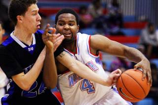 Viko Noma'aea, left, of Sierra Vista battles Kenyon Washington of Western during their boys basketball game at Western High School in Las Vegas Wednesday, January 26, 2011.