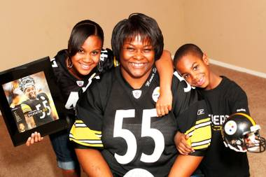 Angela Levi, mother of Pittsburgh Steelers player Stevenson Sylvester, is photographed with two of her other children, Jennifer, 16, and Jayden, 7, decked out in Steelers attire and with Stevenson's memorabilia. Stevenson played football at Valley High and will play in Super Bowl XLV on Feb. 6, 2011.