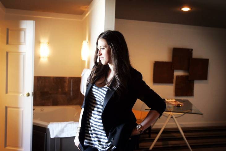 "Alexandra Epstein, El Cortez executive manager stands in ""The Big Sleep"" one of the suites that was redesigned for the Design a Suite Downtown competition at the El Cortez Thursday, January 27, 2011."