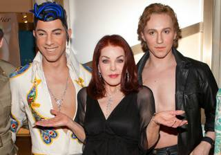 Priscilla Presley and Viva Elvis cast members at the Cartier VIP reception at MGM CityCenter's Crystals for Nevada Ballet Theatre's 27th Annual Black and White Ball on Jan. 29, 2011. Priscilla Presley was honored as NBT's Woman of the Year.