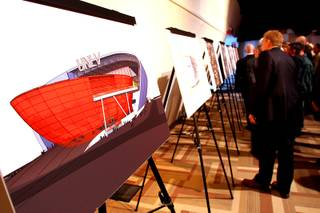 Invited guests look over conceptual renderings during a preview of a proposed on-campus, multi-use stadium for UNLV on Tuesday, Feb. 1, 2011.